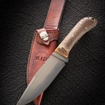 Camp knife 12 inch over all, 6.5 inch blade W2 steel, 1/4 inch thick, stabilized pine cone handle. RIP805.