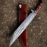 Camp knife 12 inch blade antiqued 001 tool steel, stabilized Nicholson burl handle, leather sheath by Fisher Custom Leather